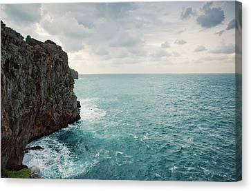 Cliff Line And Stormy Mediterranean Sea Canvas Print by Guido Mieth