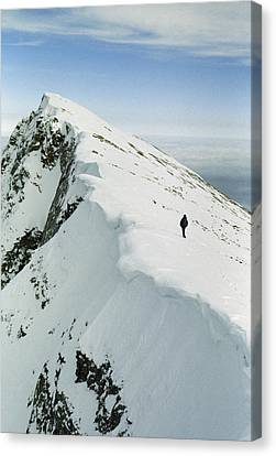 Climber Approaches False Summit Canvas Print by Gordon Wiltsie