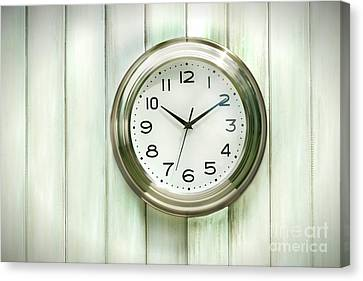 Clock On The Wall Canvas Print by Sandra Cunningham