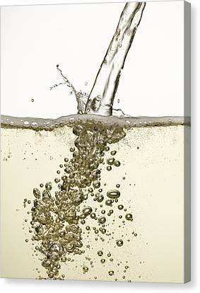 Close Up Of Champagne Being Poured Canvas Print by Andy Roberts