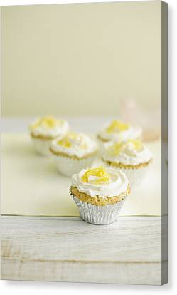 Close Up Of Cupcakes With Frosting Canvas Print by Cultura/BRETT STEVENS