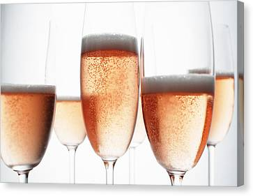 Close Up Of Glasses Of Champagne Canvas Print by Brett Stevens