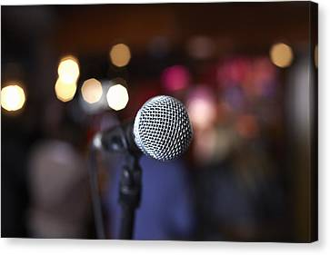Close Up Of Microphone On Stage In Lights Canvas Print by Gary John Norman