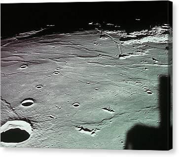 Close-up Of The Craters On The Surface Of The Moon Canvas Print by Stockbyte