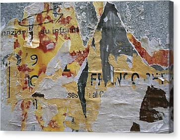 Close-up Of Torn Posters On A Wall Canvas Print by Todd Gipstein