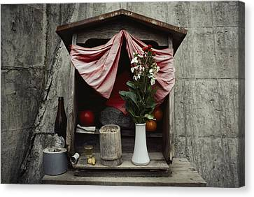 Close View Of A Shrine With Oferings Canvas Print by Sam Abell
