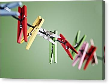 Clothesline Canvas Print - Clothes Pegs by Joana Kruse