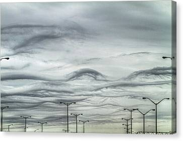 Clouds And Poles Canvas Print by Bill Lindsay