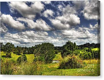 Clouds Floating Over Green Countryside Canvas Print by Kaye Menner