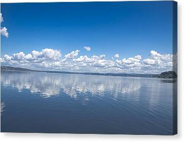 Clouds Over Water Canvas Print by Julie Smith
