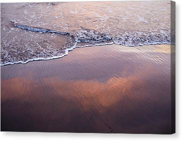 Clouds Reflected In Waves On Beach Canvas Print by Cultura Travel/Zak Kendal