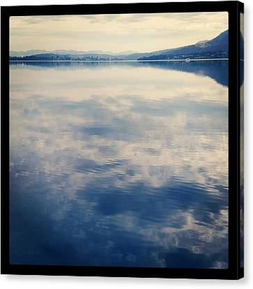 Clouds Reflected On River Canvas Print by Jodie Griggs