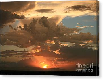 Cloudy Orange Sunset Canvas Print by Cassandra Lemon