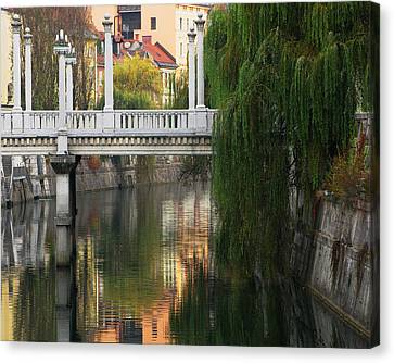 Cobblers Bridge And Morning Reflections In Ljubljana Canvas Print by Greg Matchick