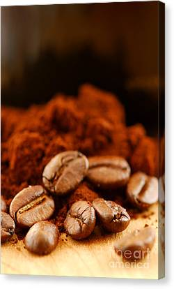 Coffee Beans And Ground Coffee Canvas Print by Elena Elisseeva