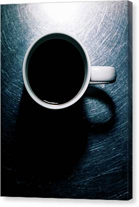 Coffee Cup On Stainless Steel. Canvas Print by Ballyscanlon