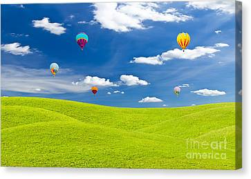 Colorful Hot Air Balloon Against Blue Sky Canvas Print by Mongkol Chakritthakool