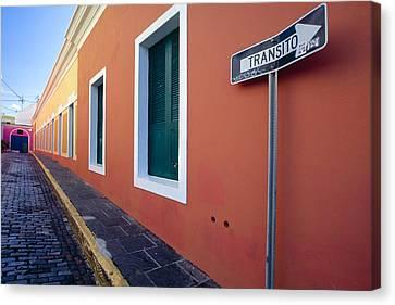 Colorful Narrow Street With A Sign Canvas Print by George Oze