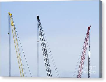 Colorful Tower Cranes Canvas Print by Jeremy Woodhouse