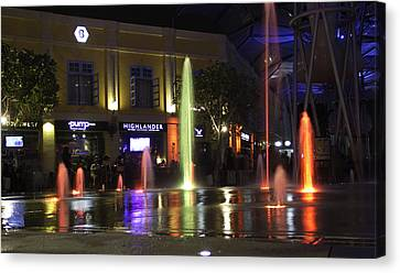 Colorful Water Jets At Clarke Quay In Singapore Canvas Print by Ashish Agarwal