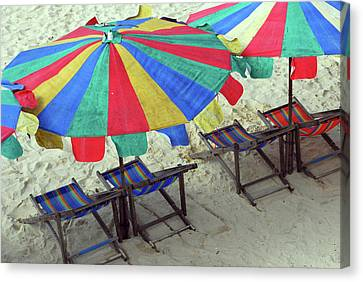 Colourful Deck Chairs And Umbrellas In Thailand Canvas Print by Thepurpledoor