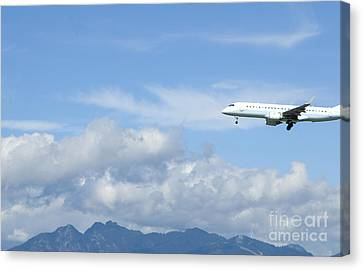 Commercial Airliner Coming In For A Landing Canvas Print by Marlene Ford