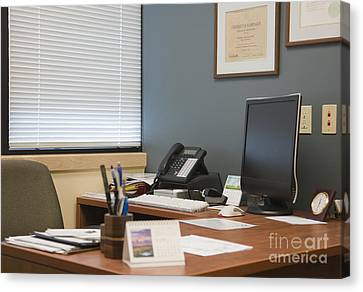 Computer Monitor And Office Space Canvas Print by Andersen Ross