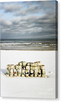 Canvas Print featuring the photograph Concrete Bricks On A Snowy Beach by Agnieszka Kubica