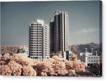 Concrete Highrise Buildings Canvas Print by Yiu Yu Hoi