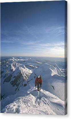 Conrad Anker Summits A Mountain Canvas Print by Jimmy Chin