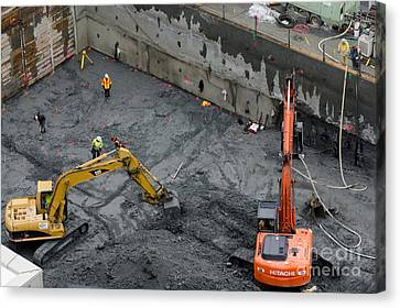 Construction Site Diggers And Workmen In The Foundation Pit Of A New Building Seattle Canvas Print by Andy Smy