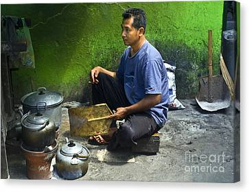 Cooking Canvas Print by Charuhas Images