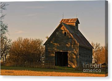 Corn Crib At Sunset Canvas Print by Edward Peterson