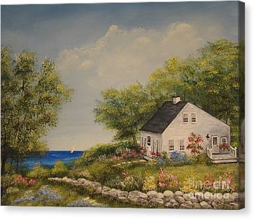 Cottage By The Lake Canvas Print by Leea Baltes