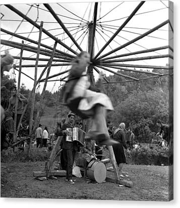 Country Fair Swings With Accordion Canvas Print by Emanuel Tanjala