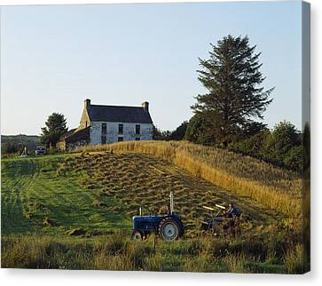 County Cork, Ireland Farmer On Tractor Canvas Print by Ken Welsh
