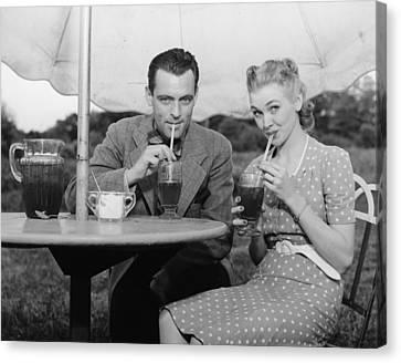 Couple Having Ice Tea Outdoors, (b&w), Portrait Canvas Print