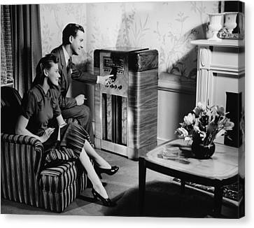 Couple Listening To Radio In Living Room, (b&w) Canvas Print by George Marks