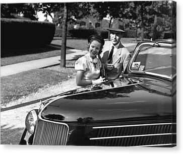 Couple Posing At Open Top Car, (b&w), Portrait Canvas Print by George Marks