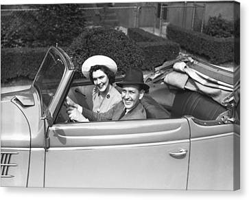 Couple Riding In Old Fashion Convertible Car, (b&w),, Portrait Canvas Print by George Marks
