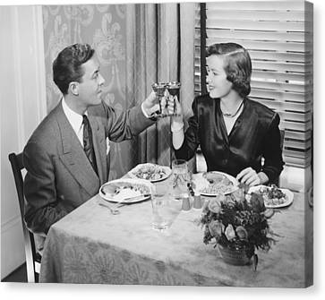 Couple Toasting At Dinner Table, (b&w), Elevated View Canvas Print by George Marks