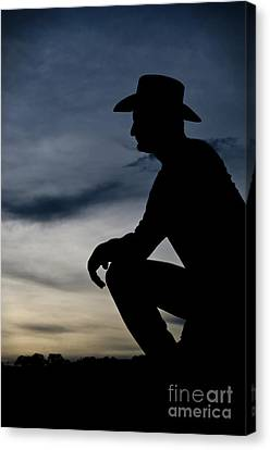Cowboy Silhouette At Sunset Canvas Print by Andre Babiak