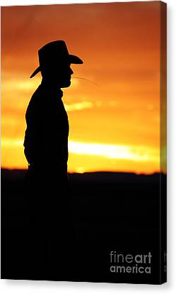 Cowboy Sunset Canvas Print by Val Armstrong