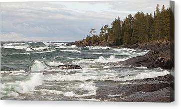 Crashing Waves On The Rocky Shoreline Canvas Print by Susan Dykstra