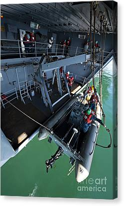 Crew Members Enter The Starboard Canvas Print