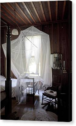 Crib With Mosquito Netting In A Florida Cracker Farmhouse Canvas Print by Lynn Palmer