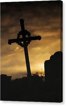 Cross At Sunset Canvas Print by John Short