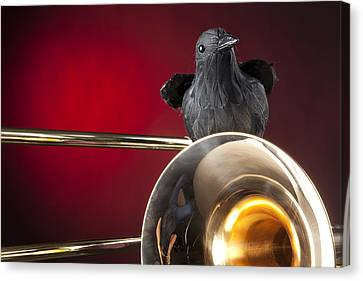 Crow And Trombone On Red Canvas Print by M K  Miller