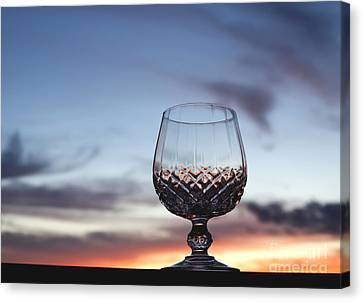 Crystal Glass Against Sunset Canvas Print by Blink Images
