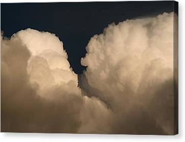 Cumulus Clashers Canvas Print by Louise Mingua